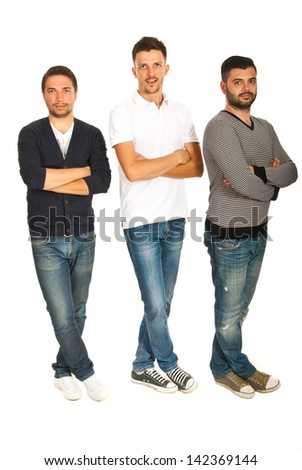 Three guys in a line standing with hands and legs crossed isolated on white background