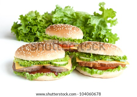 three hamburger with meat and vegetables