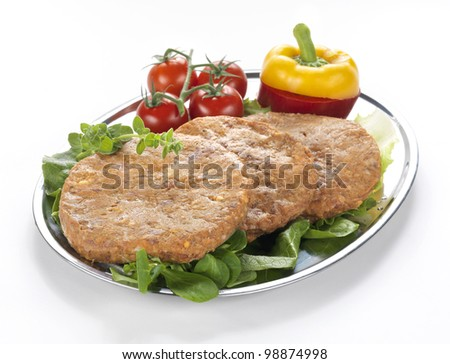 three hamburgers served on an inox dish, ready for a meat market - stock photo