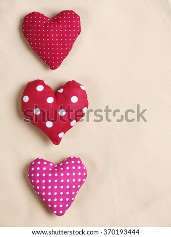 Three handmade spotted heart pillows