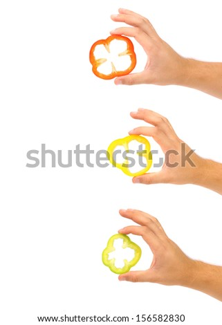 Three hands hold slice of peppers. Place for text. Isolated on a white background. - stock photo