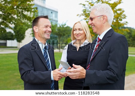 Three happy business partner people talking outside - stock photo