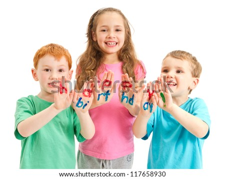 Three happy kids with happy birthday letters painted on hands. Isolated on white. - stock photo
