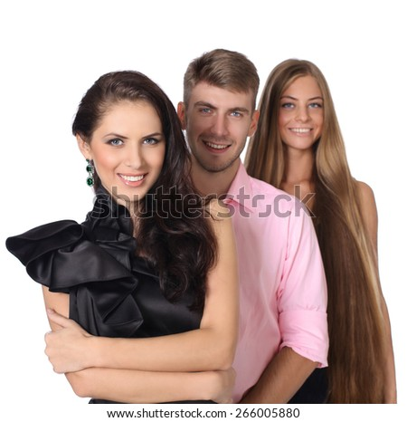 Three happy young people in studio - stock photo