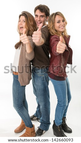 Three happy young people with thumbs up