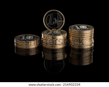 Three heaps of the Russian coins and one coin of euro it is isolated on the black