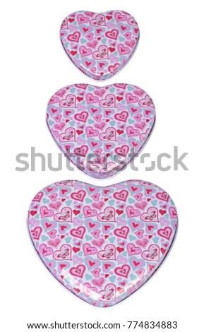 Three heart-shaped box covers with ornament of color hearts isolated on white