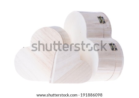 Three heart shaped wooden gift boxes isolated on white - stock photo