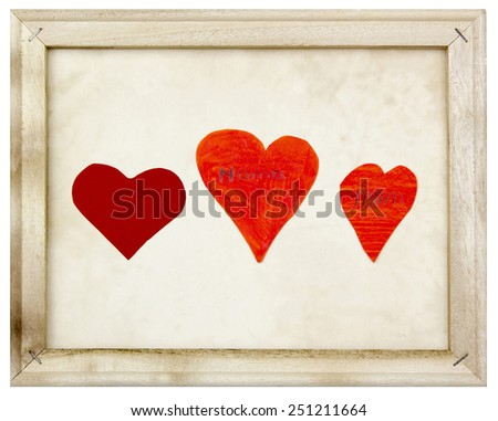 three hearts in old picture frame  - stock photo