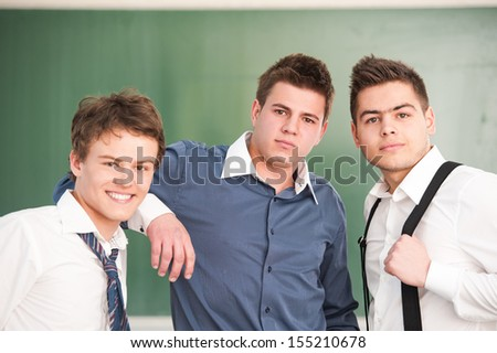 Three high school students in a classroom - stock photo