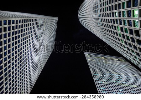 Three high tower buildings in the night  - stock photo