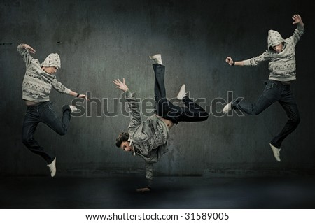 Three hip hop dancers - stock photo