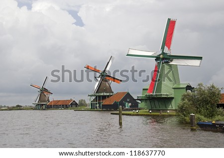 Three historical windmills at Zaandam near Amsterdam, Holland - stock photo