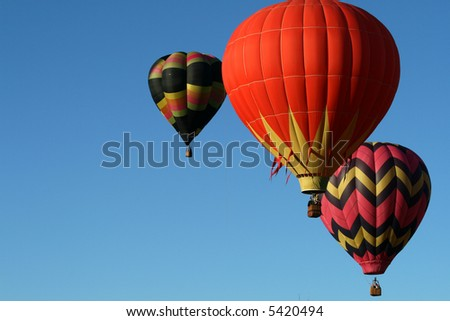 Three hot air balloons ascending - early morning - stock photo