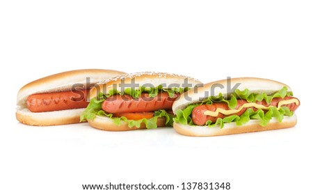 Three hot dogs with various ingredients. Isolated on white background - stock photo