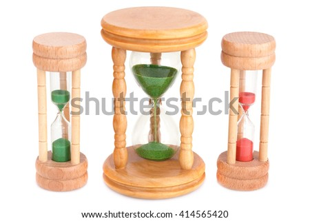 Three hourglasses isolated on white background. - stock photo