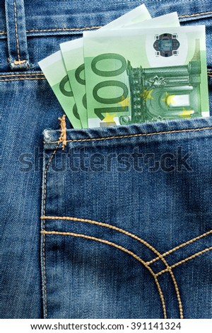 Three hundred euro banknotes in the pocket of jeans - stock photo