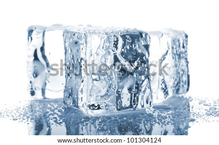 Three ice cubes with water drops isolated on white background - stock photo