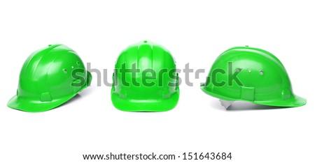 Three identical green hard hat. - stock photo