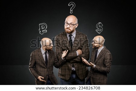 three identical men argue among themselves about important issue - stock photo