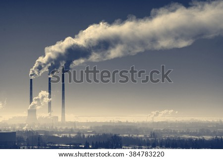 Three industrial chimney with smoke against the night sky - stock photo
