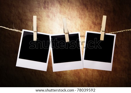 Three Instant Photos on a grunge background