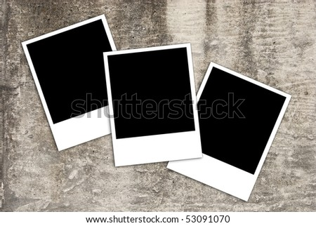 Three instant photos on stone background