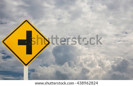 Three Intersection Sign and Storm clouds before rain