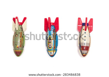 Three iron toy of missile top view isolated white background at the studio. - stock photo
