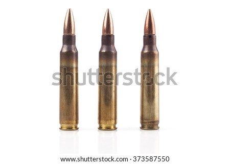 Three Isolated Bullets On White Background With Reflection - stock photo