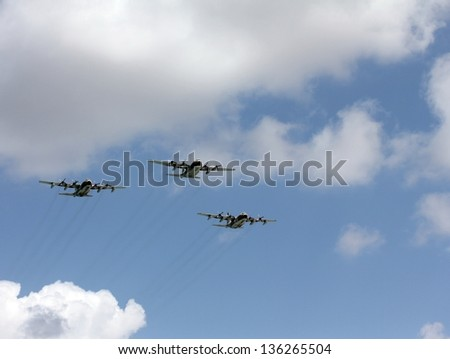 Three Israeli Air Force Hercules C-130 Transport Planes  at parade in honor of Independence Day - stock photo