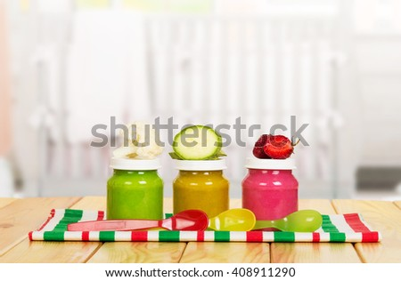 Three jar with puree for baby food on the background of the kitchen. - stock photo