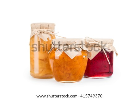 Three jars of homemade jam isolated - stock photo