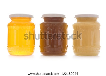Three jars of sweet honey in row isolated on white - stock photo