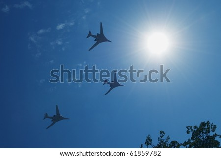 Three jet planes flying in the blue sky