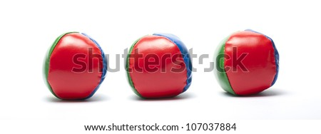 three juggle balls isolated on white