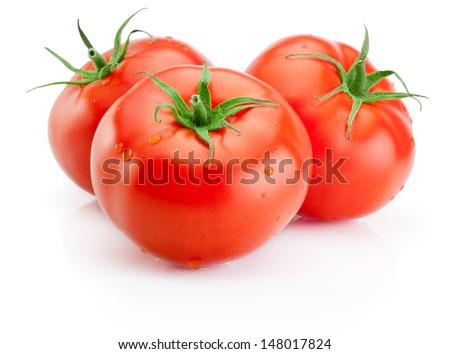 Three Juicy wet tomatoes isolated on white background - stock photo
