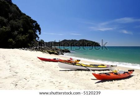 Three kayaks in Abel Tasman National Park, New Zealand - stock photo