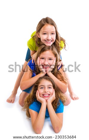 Three kid girls friends happy stacked in a row portrait on white background - stock photo