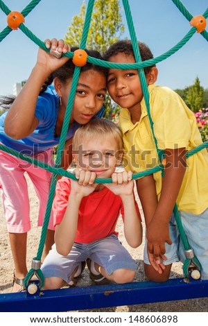 Three kids at the playground - stock photo
