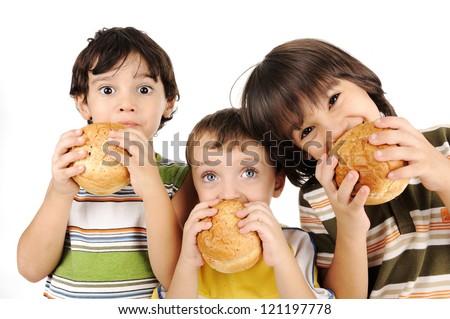 Three kids eating burgers - stock photo