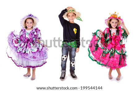 Three kids wearing generic caipira clothes as in every Festa Junina or June Festivals in Brazil. - stock photo