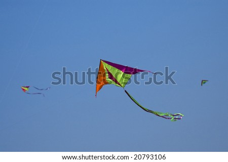 Three kites in the blue sky