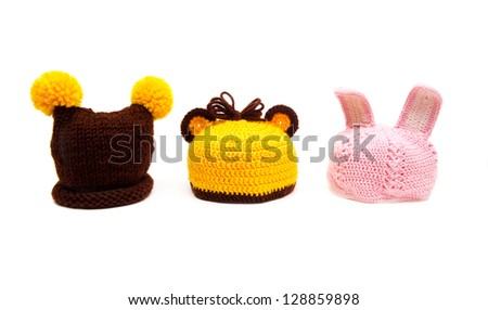 Three knitted hats for newborns isolated on white background - stock photo