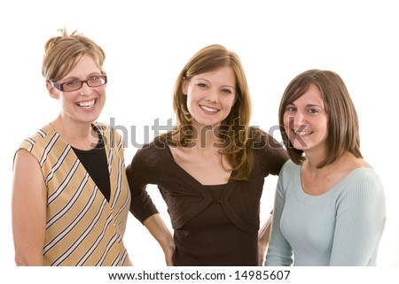 Three ladies standing together and smiling. - stock photo