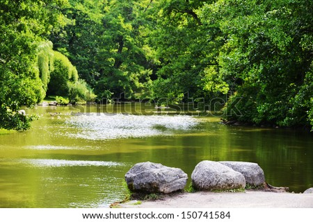 three large stone on  bank of  river. summer's day - stock photo