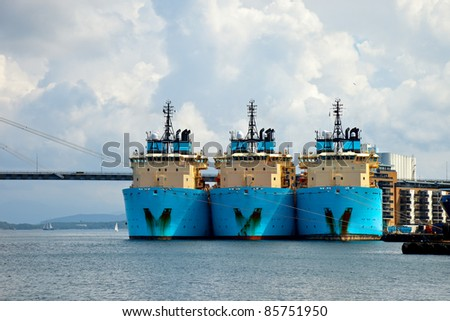 Three large tugs berth in the port of Stavanger, Norway. - stock photo