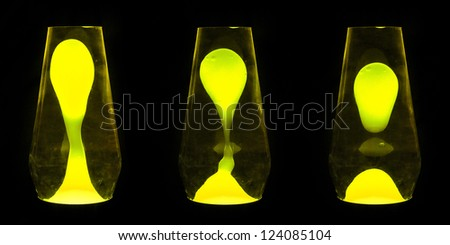 Three lava lamps showing progress of the Yellow wax going up and separating - stock photo