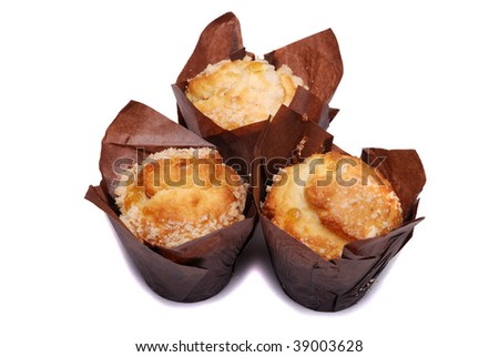 Three lemon muffins on a white background