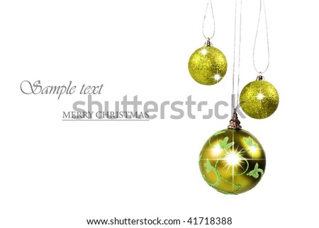 Three light green christmas baubles against white background with space for text